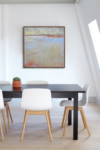 "Contemporary beige abstract ocean painting ""Migrant Shores,"" digital print by Victoria Primicias, decorates the office."