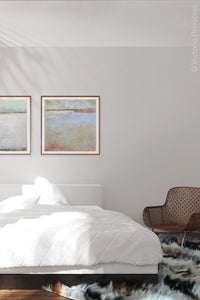 "Contemporary beige abstract ocean painting ""Migrant Shores,"" digital download by Victoria Primicias, decorates the bedroom."