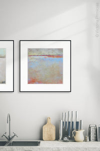 "Contemporary beige abstract beach painting ""Migrant Shores,"" digital art landscape by Victoria Primicias, decorates the kitchen."