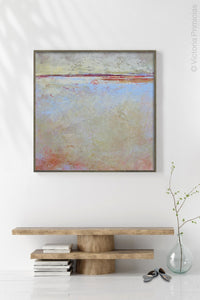 "Contemporary coastal abstract beach painting ""Migrant Shores,"" canvas print by Victoria Primicias, decorates the entryway."