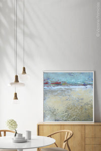 "Large abstract ocean painting ""Mint Melody,"" canvas wall art by Victoria Primicias, decorates the dining room."