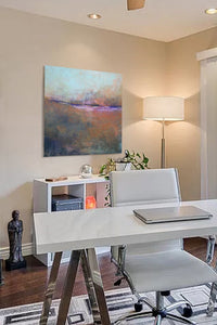 "Orange abstract ocean painting ""Minuet,"" fine art print by Victoria Primicias, decorates the office."