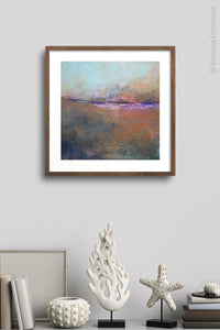 "Orange abstract landscape painting ""Minuet,"" wall art print by Victoria Primicias, decorates the shelf."