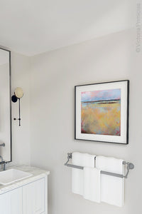 "Yellow abstract landscape painting ""Morning Gallery,"" fine art print by Victoria Primicias, decorates the bathroom."