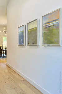 "Green abstract landscape painting ""Novel Sheets,"" fine art print by Victoria Primicias, decorates the hallway."
