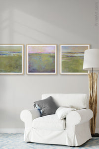 "Green landscape art ""Novel Sheets,"" giclee print by Victoria Primicias, decorates the living room."