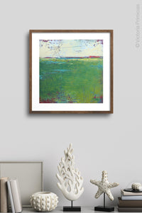 "Green abstract landscape painting ""On Course,"" fine art print by Victoria Primicias, decorates the wall."