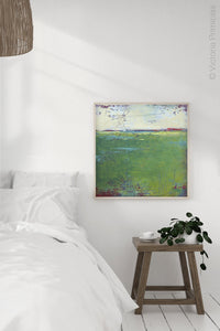 "Green abstract landscape art ""On Course,"" canvas wall art by Victoria Primicias, decorates the bedroom."