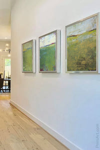 "Green abstract landscape art ""On Course,"" canvas wall art by Victoria Primicias, decorates the entryway."