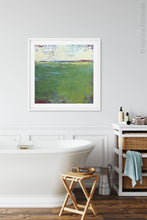 "Load image into Gallery viewer, Green abstract ocean painting ""On Course,"" giclee print by Victoria Primicias, decorates the bathroom."