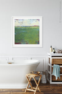"Green abstract ocean painting ""On Course,"" giclee print by Victoria Primicias, decorates the bathroom."