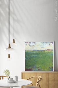 "Green abstract landscape painting ""On Course,"" fine art print by Victoria Primicias, decorates the dining room."