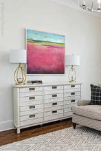 "Load image into Gallery viewer, Pink abstract beach artwork ""Painted Lady,"" canvas print by Victoria Primicias, decorates the living room."