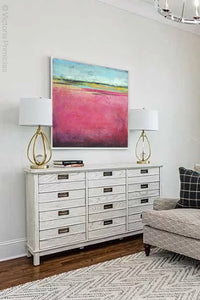 "Pink abstract beach artwork ""Painted Lady,"" canvas print by Victoria Primicias, decorates the living room."