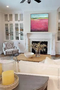 "Pink abstract beach wall decor ""Painted Lady,"" canvas wall art by Victoria Primicias, decorates the living room."