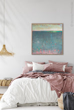 "Load image into Gallery viewer, Unique abstract ocean wall art ""Patrician Lake,"" digital print by Victoria Primicias, decorates the bedroom."