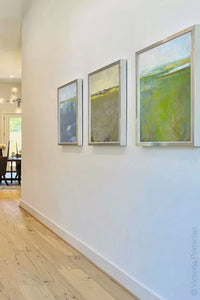"Square contemporary abstract landscape art ""Peridot Pastures,"" printable wall art by Victoria Primicias, decorates the entryway."