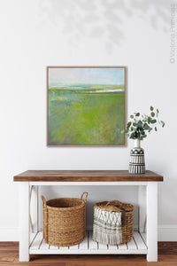 "Square contemporary abstract coastal wall art ""Peridot Pastures,"" printable wall art by Victoria Primicias, decorates the entryway."