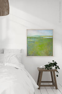 "Square contemporary abstract landscape painting ""Peridot Pastures,"" printable wall art by Victoria Primicias, decorates the bedroom."