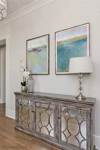 "Large abstract beach wall art ""Plum Passages,"" fine art print by Victoria Primicias, decorates the hallway."