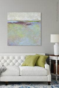 "Large abstract ocean art ""Plum Passages,"" wall art print by Victoria Primicias, decorates the living room."