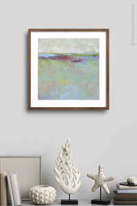 "Large abstract beach painting ""Plum Passages,"" metal print by Victoria Primicias, decorates the wall."