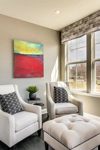"Contemporary abstract seascape painting ""Poppy Love,"" digital download by Victoria Primicias, decorates the living room."