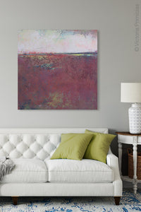 "Burgundy abstract beach art ""Red Tide,"" downloadable art by Victoria Primicias, decorates the living room."