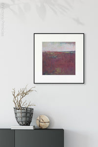 "Burgundy abstract beach art ""Red Tide,"" digital print by Victoria Primicias, decorates the entryway."