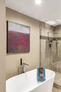 "Burgundy abstract seascape painting""Red Tide,"" digital art landscape by Victoria Primicias, decorates the bathroom."