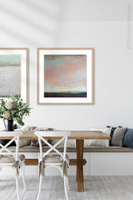 "Load image into Gallery viewer, Large abstract coastal wall art ""Retiring Sky,"" digital art landscape by Victoria Primicias, decorates the dining room."