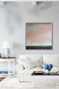 "Large abstract coastal wall art ""Retiring Sky,"" digital artwork by Victoria Primicias, decorates the living room."
