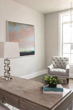 "Load image into Gallery viewer, Large abstract landscape art ""Retiring Sky,"" downloadable art by Victoria Primicias, decorates the office."