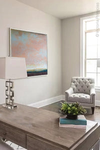 "Large abstract landscape art ""Retiring Sky,"" downloadable art by Victoria Primicias, decorates the office."