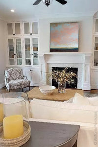 "Modern abstract landscape painting ""Retiring Sky,"" wall art print by Victoria Primicias, decorates the living room."
