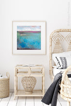 "Load image into Gallery viewer, Teal coastal abstract beach wall art ""Rising Tides,"" digital download by Victoria Primicias, decorates the bedroom."