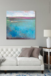 "Turquoise blue abstract beach wall decor ""Rising Tides,"" original art painting by Victoria Primicias, decorates the living room."