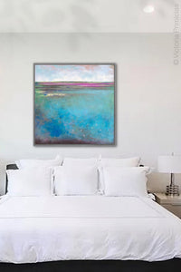 "Turquoise blue abstract coastal wall art ""Rising Tides,"" original art painting by Victoria Primicias, hangs above the bed."