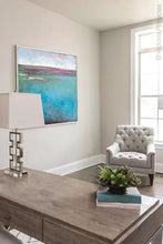 "Load image into Gallery viewer, Turquoise blue abstract coastal wall decor ""Rising Tides,"" original art painting by Victoria Primicias, decorates a home office."
