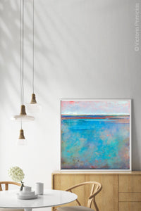 "Turquoise abstract ocean wall art ""Sea Mistress,"" canvas art print by Victoria Primicias, decorates the dining room."