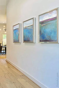"Turquoise abstract landscape painting ""Sea Mistress,"" canvas print by Victoria Primicias, decorates the entryway."