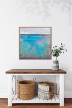 "Load image into Gallery viewer, Turquoise abstract beach wall art ""Sea Mistress,"" contemporary original art by Victoria Primicias, hangs above a console table."