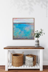 "Turquoise abstract beach wall art ""Sea Mistress,"" contemporary original art by Victoria Primicias, hangs above a console table."