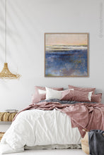 "Load image into Gallery viewer, Indigo blue abstract coastal wall art ""Secret Waters,"" digital print landscape by Victoria Primicias, decorates the bedroom."