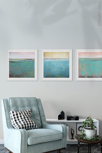 "Teal coastal abstract ocean wall art ""Shallow Harbor,"" digital download by Victoria Primicias, decorates the living room."