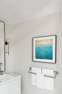 "Teal coastal abstract ocean wall art ""Shallow Harbor,"" digital art landscape by Victoria Primicias, decorates the bathroom."