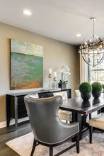 "Load image into Gallery viewer, Horizon landscape painting ""Shamrock Shoals,"" digital download by Victoria Primicias, decorates the dining room."
