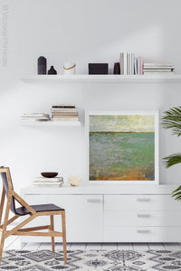 "Horizon abstract landscape painting ""Shamrock Shoals,"" digital download by Victoria Primicias, decorates the office."