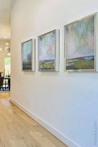"Large coastal abstract landscape art ""Shifting Winds,"" downloadable art by Victoria Primicias, decorates the hallway."