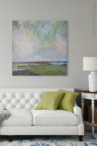 "Large coastal abstract landscape art ""Shifting Winds,"" digital artwork by Victoria Primicias, decorates the living room."
